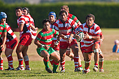 Augustine Pulu looks for his backline as he runs from broken play. Counties Manukau Premier Club Rugby game bewtween Waiuk & Karaka played at Waiuku on Saturday April 11th, 2010..Karaka won the game 24 - 22 after leading 21 - 9 at halftime.