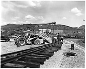 Construction of new loop in Durango yard.  Laying and spiking rails with crane and tractor with loader.<br /> D&amp;RGW  Durango, CO  Taken by Payne, Andy M. - 4/30/1968