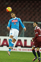 Napoli's Faouzi Ghoulam heads  for the ball during the  italian serie a soccer match,between SSC Napoli and Torino      at  the San  Paolo   stadium in Naples  Italy , January 07, 2016
