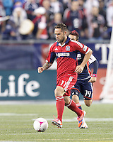 Chicago Fire midfielder Daniel Paladini (11) brings the ball forward. In a Major League Soccer (MLS) match, the New England Revolution defeated Chicago Fire, 1-0, at Gillette Stadium on October 20, 2012.
