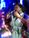 Jill Scott performs at the 2013 Essence Festival at the Mercedes-Benz Superdome in New Orleans, Louisiana.