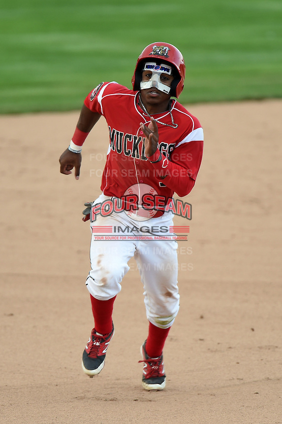 Batavia Muckdogs second baseman Mason Davis (7) running the bases wearing a face guard to protect a broken nose during the first game of a doubleheader against the Williamsport Crosscutters on July 29, 2014 at Dwyer Stadium in Batavia, New York.  Williamsport defeated Batavia 3-2.  (Mike Janes/Four Seam Images)