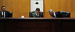 An Egyptian Judge attends the trial of ousted Egyptian president Mohammed Morsi, during the 'Qatar espionage' case, in a court in Cairo on january 2, 2015. The defendants are accused of 'leaking important national security documents and information on the Egyptian armed forces' to Qatar, through the Qatari-based al-Jazeera news network. The leaks allegedly happened during Morsi's spell as president between 2012 and 2013. Photo by Amr Sayed