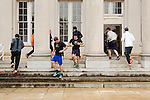 December 22, 2014. Lexington, North Carolina.<br />  Mayor Newell Clark, center, leads his workout group in a run around columns at a local business as part of their workout routine.<br />   Newell Clark, the 43 year old mayor of Lexington, NC, leads a group of friends and colleagues on a 4 times a week exercise routine around downtown. The group uses existing infrastructure, such as an abandoned furniture factory, loading docks, stairs, and handrails to get fit and increase awareness of healthy lifestyles in a town more known for BBQ.<br /> Jeremy M. Lange for the Wall Street Journal<br /> Workout_Clark