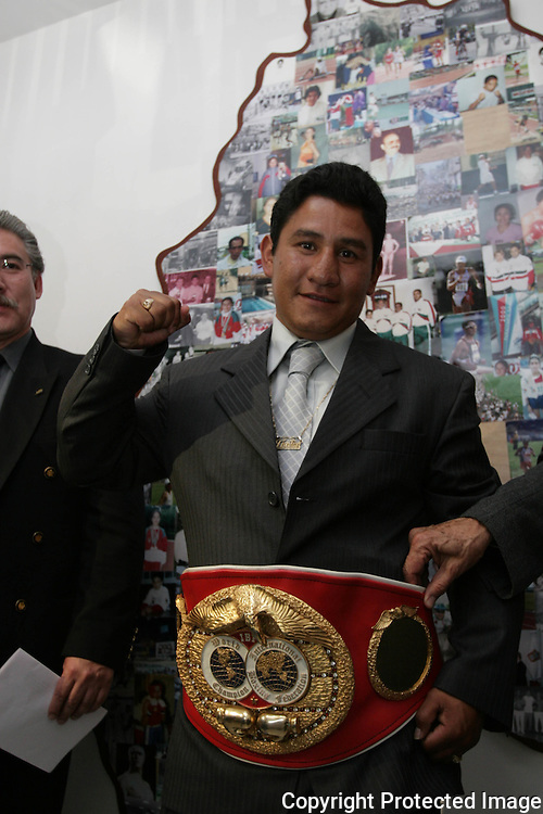 "Mexican Boxer Edgar ""Tun Tun"" Cardenas raises his fist as he shows his campion belt during a ceremony where he was accepted as a new member of the Hall of Fame in Toluca City, September 13, 2007. Photo by Javier Rodriguez"