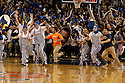 18 February 2012: Creighton Bluejays fans storm the court after defeating the Long Beach State 49ers in the Brack Busters at the CenturyLink Center in Omaha, Nebraska. Creighton defeated Long Beach State 81 to 79.
