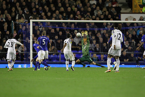 26.10.2011. Liverpool, England. Florent Malouda's shot stuns the hands of Jan Mucha in the Carling Cup match between Everton and Chelsea at Goodison Park. Mandatory Credit ActionPlus.