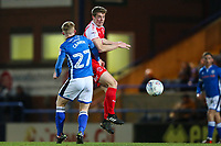 Jack Sowerby of Fleetwood Town beats Andrew Cannon of Rochdale in the air during the Sky Bet League 1 match between Rochdale and Fleetwood Town at Spotland Stadium, Rochdale, England on 20 March 2018. Photo by Thomas Gadd.