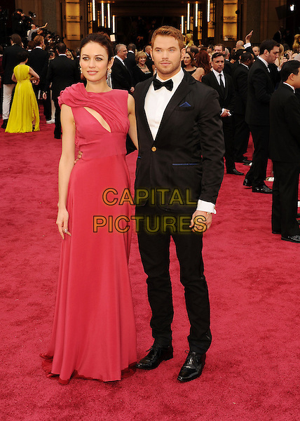 HOLLYWOOD, CA- MARCH 02: Actors Olga Kurylenko; Kellan Lutz attend the 86th Annual Academy Awards held at Hollywood &amp; Highland Center on March 2, 2014 in Hollywood, California.<br /> CAP/ROT/TM<br /> &copy;Tony Michaels/Roth Stock/Capital Pictures