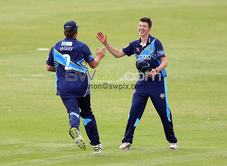 PICTURE BY VAUGHN RIDLEY/SWPIX.COM - Cricket - Yorkshire Bank 40 - Yorkshire v Leicestershire - North Marine Road, England - 09/06/13 - Yorkshire CCC's Matthew Fisher bowls and receives congratulations from teammates after his first over. Matthew has been named in the Yorkshire squad for todays YB40 game v Leicestershire.  Today, he is aged 15 yrs 212 days and has become the youngest post-War cricketer to play in one of England's county competitions.