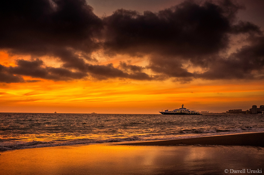 Fine Art Landscape Photograph of the Attessa IV anchored in Banderas Bay, Puerto Vallarta, Mexico. Awesome beach scene and sunset photograph of the Attessa IV which is one of the largest private yachts in the world.