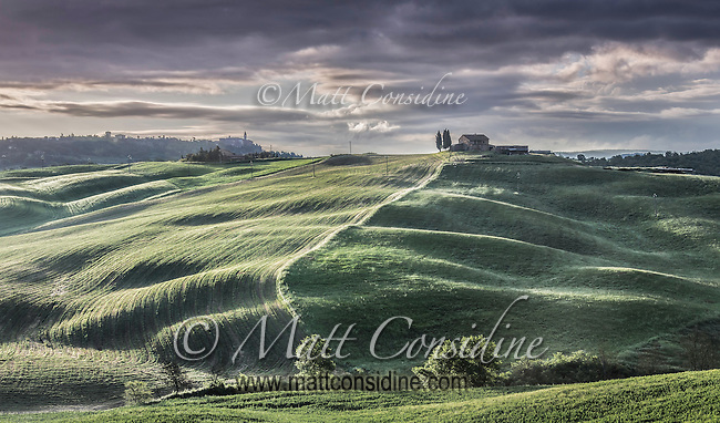 Hilltop villa and fields in afternoon light. (Photo by Travel Photographer Matt Considine)