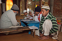 Madrasa Students with their Imam, inside Mosque under Construction.  Madrasa Islamia Arabia Izharul-Uloom, Dehradun, India.