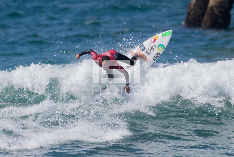 Huntington Beach, CA - Saturday August 4, 2018: Adriano de Souza in action during a World Surf League (WSL) Qualifying Series (QS) Men's Round of 16 heat at the 2018 Vans U.S. Open of Surfing on South side of the Huntington Beach pier.