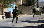 Israeli security forces take position during clashes with Palestinian protesters following a weekly demonstration against the expropriation of Palestinian land by Israel in the village of Kfar Qaddum, near the West Bank city of Nablus on September 20, 2019. Photo by Shadi Jarar'ah