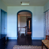 The upstairs landing is painted various shades of blue which reflects off the dark wood floors