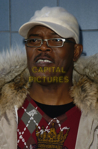 "SAMUEL L. JACKSON.Premiere of ""Black Snake Moan"" at the Chelsea West Cinemas, New York, New York, USA..February 19th, 2007.headshot portrait brown beige fur hood kangol hat glasses argyle jumper.CAP/ADM/BL.©Bill Lyons/AdMedia/Capital Pictures *** Local Caption ***"