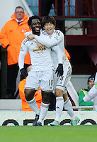 Sunday 07 December 2014<br /> Pictured L-R: Wilfried Bony of Swansea celebrating his opening goal with team mate Ki SUng Yueng<br /> Re: Premier League West Ham United v Swansea City FC at Boleyn Ground, London, UK.