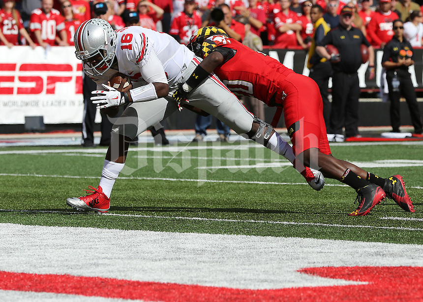 Ohio State Buckeyes quarterback J.T. Barrett (16) scores a touchdown in the fourth quarter of their game at Byrd Stadium in College Park, Maryland on October 4, 2014. (Columbus Dispatch photo by Brooke LaValley)