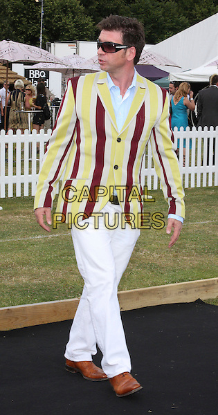 NICK KNOWLES .Duke Of Essex Polo Trophy at Gaynes Park, Epping, Essex, England, UK,.July 4th 2009..full length sunglasses looking back over shoulder yellow and red striped suit jacket blazer white trousers shoes .CAP/ROS.©Steve Ross/Capital Pictures