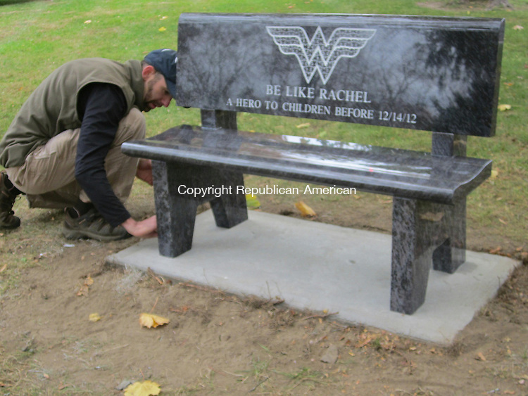 BETHLEHEM, CT - 30 Oct 2013 - 103013RH01 - Neal Burton of Burton's Monument Shop in Waterbury finishes the installation of a bench in Bethlehem's town green in memory of Rachel D'Avino, one of the six educators killed in the Dec. 14 shooting at Sandy Hook Elementary School in Newtown. Rick Harrison Republican-American