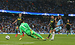 Raheem Sterling of Manchester City guides the ball past Yann Sommer of Borussia Monchengladbach only to miss the target during the UEFA Champions League Group C match at The Etihad Stadium, Manchester. Picture date: September 14th, 2016. Pic Simon Bellis/Sportimage