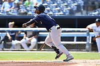 Charleston RiverDogs Frederick Cuevas (1) runs to first base during a game against the Asheville Tourists at McCormick Field on August 18, 2019 in Asheville, North Carolina. The Tourists defeated the RiverDogs 6-5. (Tony Farlow/Four Seam Images)