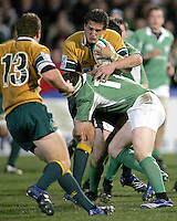 Australian skipper Brett Gillespie is smashed in this tackle by Ireland's Conor Cleary during the Division A U19 World Championship clash at Ravenhill.