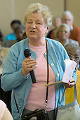 Local residents speak from the floor during a meeting of the Haringey Forum for Older People, Haringey Civic Centre, London.
