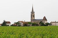 A church surrounded by Pomerol vineyards Pomerol Bordeaux Gironde Aquitaine France