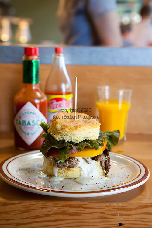 Pine State Biscuits in Portland, OR.  Pictured here is the Alberta Street store.  One of their specialty biscuits with beef and tomatoes.