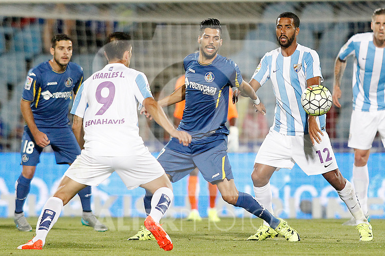 Getafe's Angel Lafita (c) and Malaga's Charles Dias (l) and Fernando Damian Tissone during La Liga match.September 18,2015. (ALTERPHOTOS/Acero)