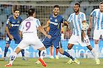 Getafe's Angel Lafita (c) and Malaga's Charles Dias (l) and Fernando Damian Tissone during La Liga match.September 18,2015. (ALTERPHOTOS/Acero)