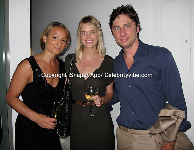 **EXCLUSIVE**.Indira Cesarine, Taylor Bagley and Zach Braff..Indira Cesarine, Founder of XXXX Magazine, Taylor Bagley a British Model on XXXX Magazine Video where she strips down and becomes topless and painted on, and Zach Braff, an American Actor on TV Show Scrubs..XXXX Magazine Celebrate the Launch of Issue No.2..Studio Cesarine..New York, NY, USA..Wednesday, June 23, 2010..Photo By iSnaper App/ CelebrityVibe.com.To license this image please call (212) 410 5354; or Email: CelebrityVibe@gmail.com ; .website: www.CelebrityVibe.com.