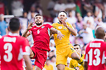 Saeed Almurjan of Jordan (L) competes for the ball with Massimo Luongo of Australia (R) during the AFC Asian Cup UAE 2019 Group B match between Australia (AUS) and Jordan (JOR) at Hazza Bin Zayed Stadium on 06 January 2019 in Al Ain, United Arab Emirates. Photo by Marcio Rodrigo Machado / Power Sport Images