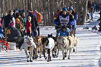 Cindy Gallea and team run past spectators on the bike/ski trail during the Anchorage ceremonial start during the 2014 Iditarod race.<br /> Photo by Britt Coon/IditarodPhotos.com