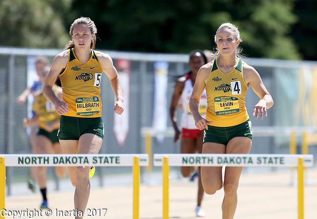 FARGO, ND - MAY 13: Morgan Milbrath, left, and Amanda Levin from North Dakota State University battle to the finish line in the women's 400 meter hurdles Saturday at the 2017 Summit League Outdoor Track Championship at the Ellig Sports Complex in Fargo, ND. Milbrath won the race over Levin. (Photo by Dave Eggen/Inertia)