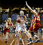 SIOUX FALLS MARCH 22:  Piper Tucker #11 of Grand Valley State drives toward Kylie Gafford #23 of Pittsburg State during their quarterfinal game at the NCAA Women's Division II Elite 8 Tournament at the Sanford Pentagon in Sioux Falls, S.D.  In the background is Hadyn Herlocker #12 of Pittsburg. (Photo by Dick Carlson/Inertia)