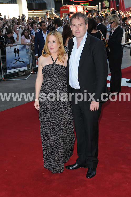**ALL ROUND EXCLUSIVE PICTURES FROM SOLARPIX.COM**.**WORLDWIDE SYNDICATION RIGHTS**.The X Files film premiere at the empire cinema Leicester square London..This pic: Gillian Anderson.JOB REF:6937-MSR    DATE:30_07_08 .**MUST CREDIT SOLARPIX.COM OR DOUBLE FEE WILL BE CHARGED* *UNDER NO CIRCUMSTANCES IS THIS IMAGE TO BE REPRODUCED FOR ANY ONLINE EDITION WITHOUT PRIOR PERMISSION*