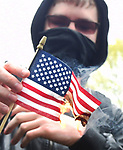 (Boston MA 05/13/17) Anti Trump protesters lit small U.S. flags on fire, during a large demonstration on 6 different militias and a counter protest, Saturday, May 13, 2017, on the Boston Common. . Herald Photo by Jim Michaud