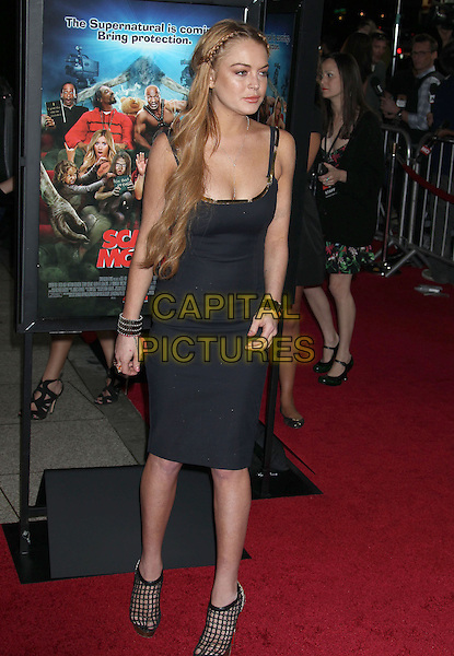 "Lindsay Lohan.Attending the ""Scary Movie 5"" Los Angeles film premiere held at the Cinerama Dome, Hollywood, California, USA,.11th April 2013..full length swollen puffy face lips swollen dress black cleavage plaits hair braids platform  tanned fake tan necklace cross trim straps gold bracelets fishnet shoes cut out ankle boots shooboots heels  .CAP/ADM/RE.©Russ Elliot/AdMedia/Capital Pictures"