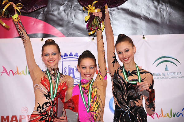 (L-R) Nataliya Balycheva (silver), Anna Trubnikova (gold) of Russia and Viktoriya Shynkarenko of Ukraine (bronze) are junior winners at 2010 Grand Prix Marbella at San Pedro Al Cantara, Spain on May 14, 2010.  (Photo by Tom Theobald).
