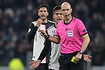 Paulo Dybala of Juventus protests to the referee Anthony Taylor over the booking of team mate Rodrigo Bentancur in the background during the UEFA Champions League match at Juventus Stadium, Turin. Picture date: 26th November 2019. Picture credit should read: Jonathan Moscrop/Sportimage