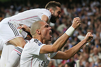 Real Madrid's Portuguese defense Pepe celebrating goal of Chicharito
