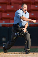 Home plate umpire Tim Rosso makes an emphatic call on a play at the plate during a South Atlantic League game between the Rome Braves and the Hickory Crawdads at  L.P. Frans Stadium May 23, 2010, in Hickory, North Carolina.  Photo by Brian Westerholt / Four Seam Images