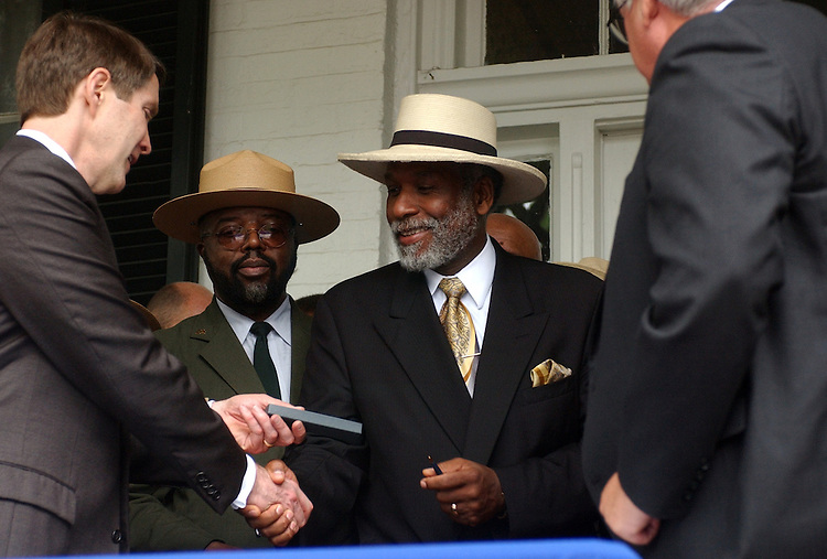 douglass5/050803 -  Senate Majority Leader Bill Frist, R-Tenn., shakes hands with Frederick Douglass IV, and gives him a pen used to sign legislation with Speaker Dennis Hastert, R-Ill., that would include nearly a million dollars in the FY 2004 budget, to complete restorstion of the Fredrick Douglass home, known as Cedar Hill, located in Anacostia.