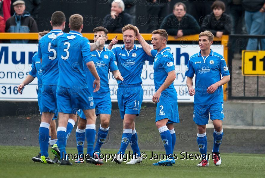 Queen of the South's Iain Russell (11) celebrates with team mates after he scores their first goal.