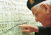 """Canadian veteran Richard Ross points at the name """"F. Hucker"""" that has been worn down...Photo taken 10 May 2000 at the Canadian War Memorial at Vimy, France..Credit: Justin Jin"""