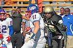 Palos Verdes, CA 09/24/10 - Walt Proenca (Peninsula #56) and Conner Preston (Serra #11) in action during the Serra-Peninsula varsity football game at Peninsula High School.