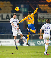 Max Muller of Wycombe Wanderers beats Matt Green of Mansfield Town in the air during the The Checkatrade Trophy  Quarter Final match between Mansfield Town and Wycombe Wanderers at the One Call Stadium, Mansfield, England on 24 January 2017. Photo by Andy Rowland.